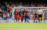 Pictured: Andre Schurrle of Chelsea takes a free kick (14) which goes over the Swansea wall. Saturday 13 September 2014<br /> Re: Premier League Chelsea FC v Swansea City FC at Stamford Bridge, London, UK.