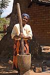 Pounding maize for ugali (porridge)