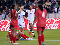 HOUSTON, TX - JANUARY 31: Jess McDonald #14 and Lindsey Horan #9 of the United States celebrates during a game between Panama and USWNT at BBVA Stadium on January 31, 2020 in Houston, Texas.