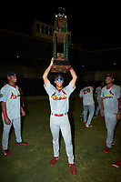 Trejyn Fletcher (34) of the Johnson City Cardinals holds the Appalachian League trophy over his head following the win over the Burlington Royals at Burlington Athletic Stadium on September 4, 2019 in Burlington, North Carolina. The Cardinals defeated the Royals 8-6 to win the 2019 Appalachian League Championship. (Brian Westerholt/Four Seam Images)