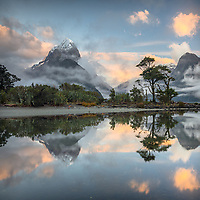 Dawn over Milford Sound with Mitre Peak in clouds, Fiordland National Park, Southland, UNESCO World Heritage Area, New Zealand
