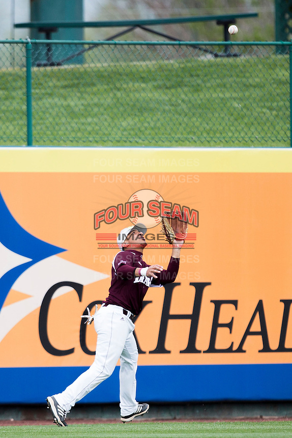 Keenen Maddox #1 of the Missouri State Bears attempts to catch a ball in left field during a game against the Wichita State Shockers at Hammons Field on May 5, 2013 in Springfield, Missouri. (David Welker/Four Seam Images)
