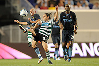 Stephen Ireland (7) of Manchester City F. C. and Nuno Ribeiro (Maniche) (8) of Sporting Clube de Portugal go for a ball during a Barclays New York Challenge match between Manchester City F. C. and Sporting Clube de Portugal (Sporting Lisbon) at Red Bull Arena in Harrison, NJ, on July 23, 2010.