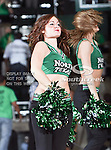North Texas Mean Green dance team members in action during the NCAA  basketball game between the University of Louisiana at Monroe Warhawks and the University of North Texas Mean Green at the North Texas Coliseum,the Super Pit, in Denton, Texas. ULM defeated UNT 82 to 75...