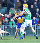 David Mc Inerney of  Clare  in action against Seamus Flanagan of  Limerick during their NHL quarter final at the Gaelic Grounds. Photograph by John Kelly.