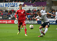 Pictured: James Ward-Prowse of England is kicking the ball away, against him Lee Evans of Wales (L). Monday 19 May 2014<br />