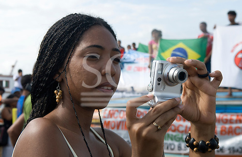 """Altamira, Brazil. """"Xingu Vivo Para Sempre"""" protest meeting about the proposed Belo Monte hydroeletric dam and other dams on the Xingu river and its tributaries. Woman holding a digital camera."""