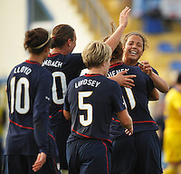 L to R - Carli Lloyd #10, Abby Wambach #20, Lori Lindsey #5 watch #11 Lauren Cheney and #15 Casey Nogueira #15 celebrate Cheney's second goal of the game vs Sweden in Ferreiras, Portugal during the 2010 Algarve Cup.