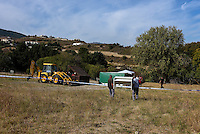 """Pictured: A digger next tos a forensics tent in a field in Kos, Greece. Monday 26 September 2016<br /> Re: Police teams searching for missing toddler Ben Needham on the Greek island of Kos have said they are """"optimistic"""" about new excavation work.<br /> Ben, from Sheffield, was 21 months old when he disappeared on 24 July 1991 during a family holiday.<br /> Digging has begun at a new site after a fresh line of inquiry suggested he could have been crushed by a digger.<br /> South Yorkshire Police (SYP) said it continued to keep an """"open mind"""" about what happened to Ben."""