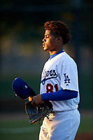 AZL Dodgers Lasorda starting pitcher Igor Avila (81) walks off the mound during a pitching change in an Arizona League game against the AZL Athletics Green at Camelback Ranch on June 19, 2019 in Glendale, Arizona. AZL Dodgers Lasorda defeated AZL Athletics Green 9-5. (Zachary Lucy/Four Seam Images)