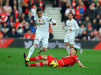 Saturday 10 November 2012<br /> Pictured L-R: Pablo Hernandez of Swansea avoids a challenge by Adam Lallana of Southampton  <br /> Re: Barclay's Premier League, Southampton FC v Swansea City FC at St Mary's Stadium, Southampton, UK.