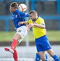 Cowdenbeath's Lewis Coult and Morton's Mark McLaughlin challenge for the ball ...
