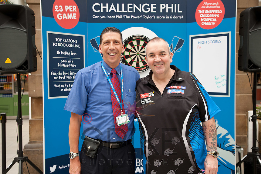 Phil 'The Power' Taylor raised money for The Children's Hospital Charity by challenging the public at darts at Sheffield Train Station. He's pictured with East Midlands Trains driver Martin Johnson