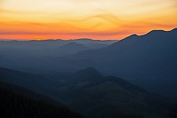 Sunset with smoky sky over Sol Duc Valley from Merrill Ring property.  Olympic Peninsula, Washington.  Sept.
