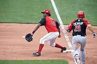 Team USA first baseman Josh Bell (47) picks a throw as Balbino Fuenmayor (28) runs up the base line during the MLB All-Star Futures Game on July 12, 2015 at Great American Ball Park in Cincinnati, Ohio.  (Mike Janes/Four Seam Images)