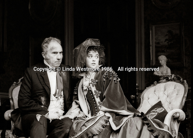 """Mr Posket (Nigel Hawthorne) and Agatha Posket (Gemma Craven) in """"The Magistrate"""" by Arthur Wing Pinero, directed by Michael Rudman, designed by Carl Toms, National Theatre, London, 1986."""