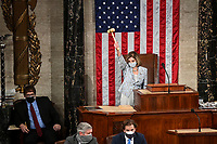 Speaker of the United States House of Representatives Nancy Pelosi (Democrat of California) waves the gavel on the opening day of the 117th Congress at the U.S. Capitol in Washington, DC on on January 03, 2021.<br /> CAP/MPI/RS<br /> ©RS/MPI/Capital Pictures