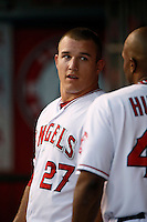 Mike Trout #27 of the Los Angeles Angels talks with teammate Torii Hunter #48 during a game against the Chicago White Sox at Angel Stadium on September 22, 2012 in Anaheim, California. Los Angeles defeated Chicago 4-2. (Larry Goren/Four Seam Images)