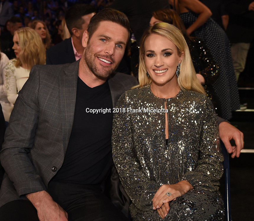NASHVILLE, TN - JUNE 6: (L-R) Mike Fisher and Carrie Underwood attend the 2018 CMT Music Awards at the Bridgestone Arena on June 6, 2018 in Nashville, Tennessee. (Photo by Frank Micelotta/PictureGroup)