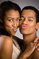 Young Hispanic couple making faces
