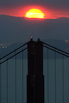 The sun rose directly over the northtower of the Golden Gate in fowl weather up in the Marin Headlands..