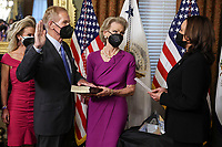 U.S. Vice President Kamala Harris, right, swears in Bill Nelson, left, former Democratic Senator from Florida and administrator of the National Aeronautics and Space Administration (NASA), alongside his wife, Grace Nelson, holding the bible, in the Eisenhower Executive Office Building in Washington, D.C., U.S., on May 3, 2021. The Senate confirmed Nelson on April 29 and had served as the chairman and ranking member of the Senate subcommittee that oversees NASA. <br /> Credit: Oliver Contreras / Pool via CNP /MediaPunch