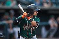 Nick Gonzales (2) of the Greensboro Grasshoppers at bat against the Winston-Salem Dash at Truist Stadium on August 11, 2021 in Winston-Salem, North Carolina. (Brian Westerholt/Four Seam Images)