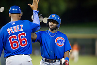 AZL Cubs shortstop Delvin Zinn (21) reaches for a high five from assistant hitting coach Leonel Perez (66) during a game against the AZL Giants on September 5, 2017 at Scottsdale Stadium in Scottsdale, Arizona. AZL Cubs defeated the AZL Giants 10-4 to take a 1-0 lead in the Arizona League Championship Series. (Zachary Lucy/Four Seam Images)