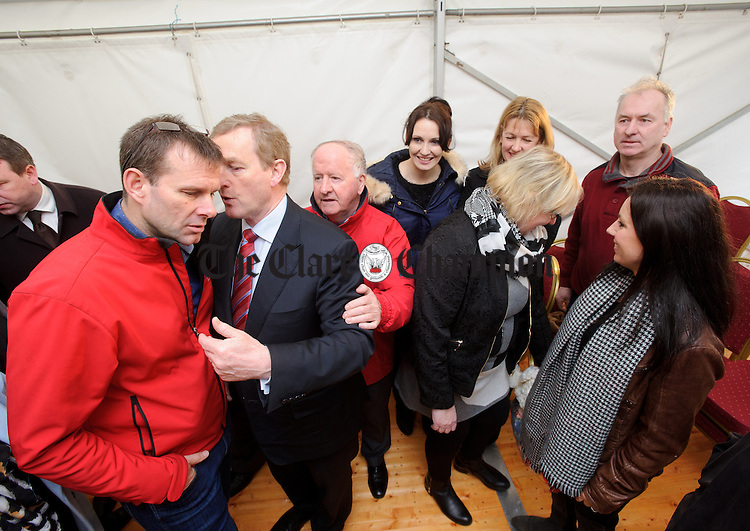 Enda Kenny, Taoiseach, has a word with Cillian Murphy, chairman of Loop Head Tourism, during his visit to Loop Head to launch the Fine Gael tourism initiative. Photograph by John Kelly.