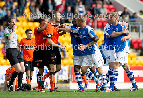 St Johnstone v Dundee United....01.09.12      SPL  .Sean Dillon and John Rankin sqaure up to Gregory Tade and Rowan Vine after Willo Flood's lunge on Gregory Tade.Picture by Graeme Hart..Copyright Perthshire Picture Agency.Tel: 01738 623350  Mobile: 07990 594431