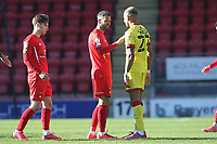 Players shake hands at the final whistle during Leyton Orient vs Walsall, Sky Bet EFL League 2 Football at The Breyer Group Stadium on 5th April 2021