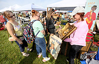 Connie Tolbert (from right) visits with Katelyn Jones, Shannon Morters and Robin Gist Friday, June 4, 2021, about an English painting at her booth during the Junk Ranch Spring Show in Prairie Grove. The show continues today featuring vintage, antique, handmade, repurposed, jewelry, boutique, and salvage items with food trucks and live music. Check out nwaonline.com/210605Daily/ and nwadg.com/photos for a photo gallery.<br /> (NWA Democrat-Gazette/David Gottschalk)