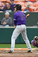 Third baseman Jake Crawford (19) of the Furman Paladins bats in a game against the Clemson Tigers on Tuesday, February 20, 2018, at Doug Kingsmore Stadium in Clemson, South Carolina. Clemson won, 12-4. (Tom Priddy/Four Seam Images)