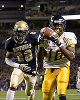 Pittsburgh Linebacker Tommie Campbell can't keep up with West Virginia Running Back Steve Slaton as Slaton makes an 11-yard touchdown catch. The WVU Mountaineers beat the Pitt Panthers 45-27 on November 16, 2006 at Heinz Field, Pittsburgh, Pennsylvania.