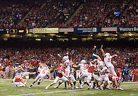 Zach Hocker of Arkansas kicks a field goal against Ohio State during 77th Annual Allstate Sugar Bowl Classic between Ohio State and Arkansas at Louisiana Superdome in New Orleans, Louisiana on January 4th, 2011.  Ohio State defeated Arkansas, 31-26.
