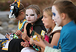 From left, Logan McKenna, 8, Kathleen Brendel, 8, Jael Graham, 8, and Mallory Brendel, 10, eat candy following the Carson City Boo-nanza at the Community Center on Wednesday, Oct. 25, 2017. Co-hosted by Carson City Parks and Recreation, the Carson City Library and the Carson City Aquatics Facility, hundreds of families participate in the event which includes trick-or-treating, a haunted house, games, crafts, a dive-in movie and more.<br /> Photo by Cathleen Allison/Nevada Momentum