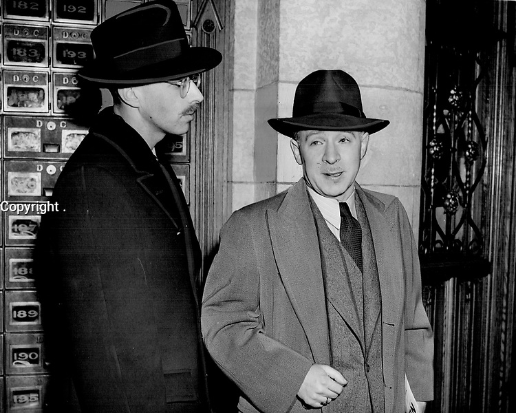 Fred Rose et Guy Caron, 1945<br /> <br /> Back In the House of Commons yesterday; Fred Rose; M.P.; held in connection with alleged spy ring activities; is seen right; with Guy Caron; Quebec L.-P. Party leader, 1945<br /> <br /> PHOTO : Toronto Star Archives - AQP