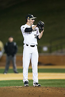 Wake Forest Demon Deacons relief pitcher Morgan McSweeney (35) looks to his catcher for the sign against the Kent State Golden Flashes in game two of a double-header at David F. Couch Ballpark on March 4, 2017 in Winston-Salem, North Carolina.  The Demon Deacons defeated the Golden Flashes 5-0.  (Brian Westerholt/Four Seam Images)