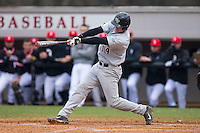 Conor Keniry (14) of the Wake Forest Demon Deacons follows through on his swing against the Davidson Wildcats at Wilson Field on March 19, 2014 in Davidson, North Carolina.  The Wildcats defeated the Demon Deacons 7-6.  (Brian Westerholt/Four Seam Images)