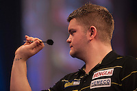 21.12.2014.  London, England.  William Hill World Darts Championship.  Ryan De Vreede [NED] in action in his match with Dave Chisnall (8) [ENG]. Chisnall won the match 3-0