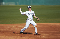Wingate Bulldogs third baseman Clayton Nestor (23) makes a throw to first base against the Concord Mountain Lions at Ron Christopher Stadium on February 2, 2020 in Wingate, North Carolina. The Mountain Lions defeated the Bulldogs 12-11. (Brian Westerholt/Four Seam Images)
