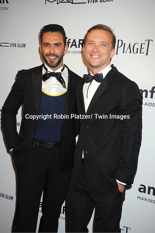 Lorenzo Martone and guest attends the amfAR Inspiration Gala on June 7, 2012 at The New YOrk Public Library in New York City. The honorees were Fergie and Robert Duffy/ Marc Jacobhs International and the Scissor Sisters performed.