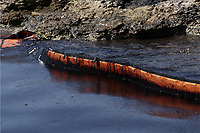 """Pictured: A floating barrier used to contain the oil spill that has reached the coast of Salamina, Greece<br /> Re: An oil spill off Salamina island's eastern coast is spreading and has become """"an environmental disaster"""" according to local authorities in Greece.<br /> The spill was caused by the sinking of the Aghia Zoni II tanker, carrying 2,200 metric tons of fuel oil and 370 metric tons of marine gas oil on Saturday, southwest of the islet of Atalanti near Psytalleia. According to reports, the coastline stretching from Kinosoura to the Selinia community has """"turned black"""" and authorities fear a new leak from the sunken ship.<br /> According to the island's mayor, Isidora Papathanasiou, the weather """"turned on Sunday afternoon and brought the oil spill to Salamina."""""""