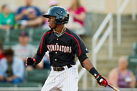 Tim Anderson (2) of the Kannapolis Intimidators follows through on his swing against the Greenville Drive at CMC-Northeast Stadium on June 29, 2013 in Kannapolis, North Carolina.  The Drive defeated the Intimidators 5-3.   (Brian Westerholt/Four Seam Images)