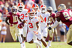 Clemson wide receiver Amari Rodgers keeps an eye on Florida State defensive end Walvenski Aime (94) after a reception in the first half of an NCAA college football game in Tallahassee, Fla., Saturday, Oct.27, 2018. (AP Photo/Mark Wallheiser)