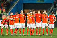 The Netherlands team watch on nervously during the penalty shoot out
