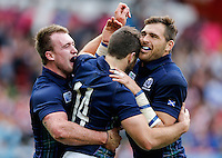 Scotland Winger Tommy Seymour celebrates with Full Back Stuart Hogg and Winger Sean Lamont after scoring a try - Mandatory byline: Rogan Thomson - 23/09/2015 - RUGBY UNION - Kingsholm Stadium - Gloucester, England - Scotland v Japan - Rugby World Cup 2015 Pool B.