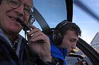 Pilots Paul Thomas and Etienne Teillet in a Schweizer helicopter on startup at the Beloeil Airport, Quebec, Canada