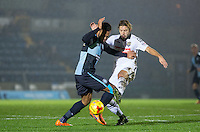 Aaron Holloway of Wycombe Wanderers & Alan Smith of Notts County battle for the ball during the Sky Bet League 2 match between Wycombe Wanderers and Notts County at Adams Park, High Wycombe, England on 15 December 2015. Photo by Andy Rowland.