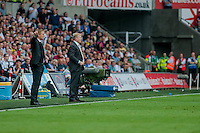 Saturday 20th September 2014  Pictured:  ( L-R )  Garry Monk, Manager of Swansea City and Ronald Koeman, Manager of Southampton in the dugout at the liberty <br /> Re: Barclays Premier League Swansea City v Southampton  at the Liberty Stadium, Swansea, Wales,UK